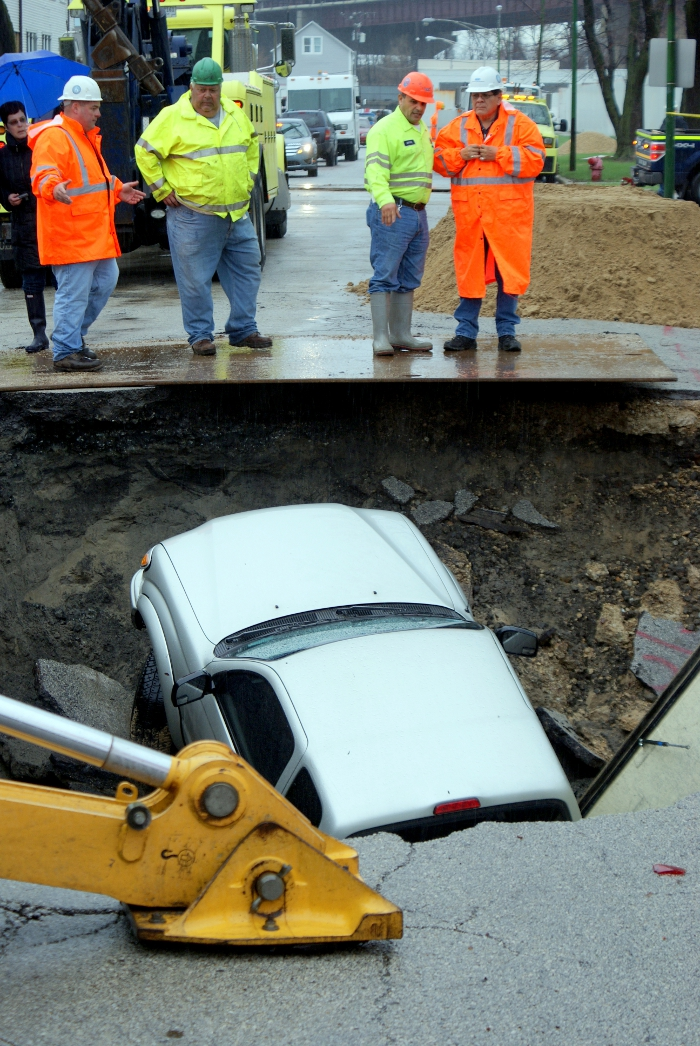 Photos: Huge Sinkhole Swallows Three Cars on Chicago's South Side