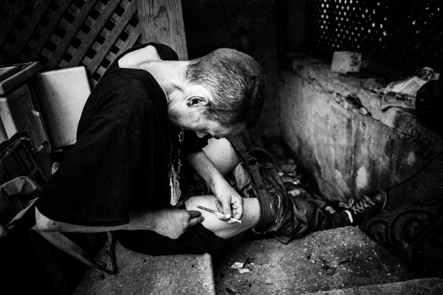 CHICAGO, ILLINOIS - SEPTEMBER 2, 2014 - Heroin addicts often find refuge in and around abandoned houses. This house is located in K-Town, and is a regular spot where addicts stop to inject after purchasing their heroin.