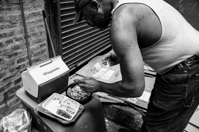 """People throw away so much good shit, you'd have to be retarded to go hungry out here,"" Victor explains as he prepares his dumpster-dive lunch in a Chicago alley."