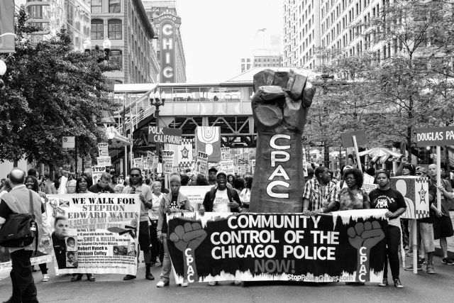 CHICAGO, IL. Aug. 29, 2015 - Protesters march down State Street in Chicago's Loop to demand that the City Council create a civilian police accountability council.