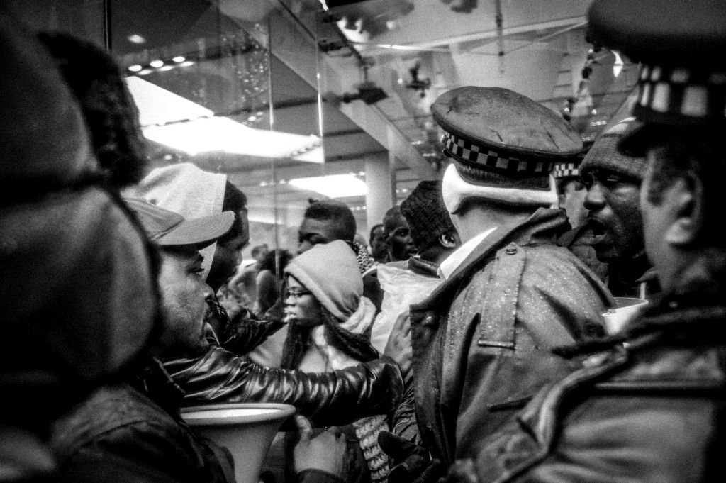 Pandemonium ensues as the Chicago police attempt to remove demonstrators from blocking the entrance, and attempted to enter, the Apple Store on North Michigan Avenue during a Black Friday demonstration. The protest was in response to the shooting death of 17-year-old Laquan McDonald by Chicago police Officer Jason Van Dyke in 2014.