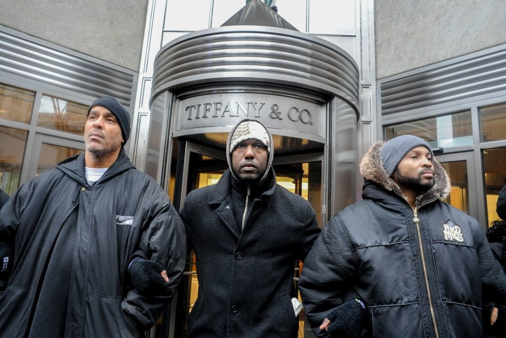 CHICAGO, IL. Nov. 27, 2015 - Demonstrators block shoppers from entering stores along Chicago's Magnificent Mile during a Black Friday protest in response to the shooting death of Laquan McDonald by Chicago Police officer, Jason Van Dyke.