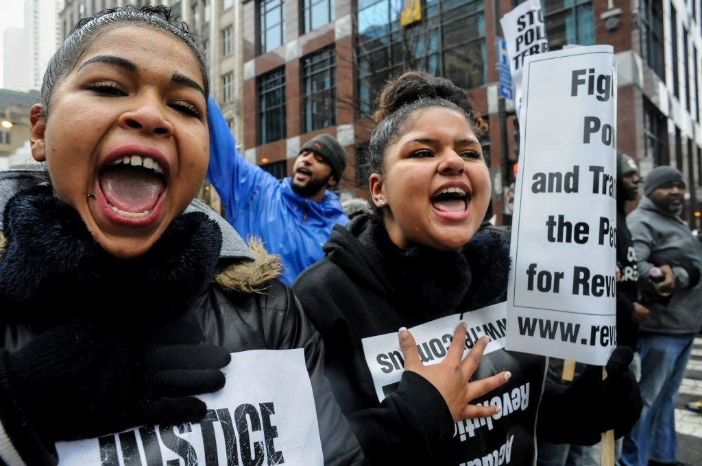"""CHICAGO, IL. Nov. 27, 2015 - Demonstrators chant """"Hey hey! Ho ho! Rahm Emmanuel has got to go"""" during a protest march down Chicago's Magnificent Mile. The Black Friday protest was sparked off in response to the shooting death of Laquan McDonald by a Chicago Police office back in 2014."""