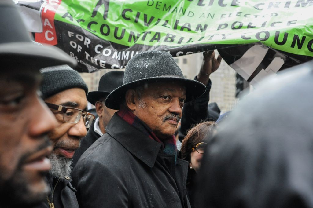 CHICAGO, IL. Nov. 27, 2015 - The Reverend Jesse Jackson leads several thousand demonstrators down Chicago's Magnificent Mile during a Black Friday protest, which was held in response to the shooting death of Laquan McDonald by a Chicago Police office back in 2014.