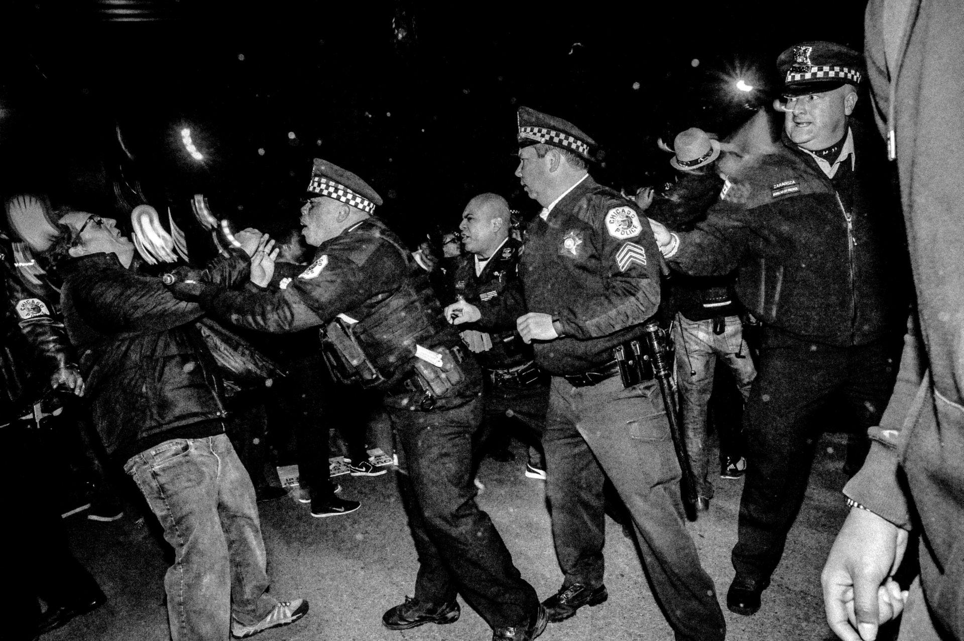 A Bernie Sanders supporter clashes with police in Chicago during an anti-Trump riot.