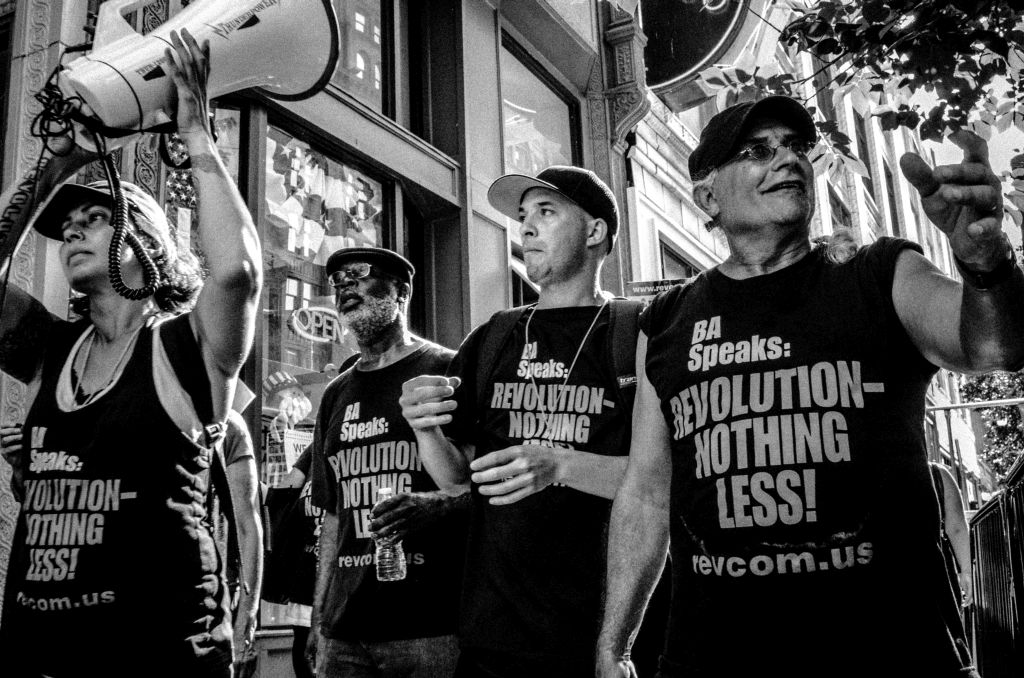"""Cleveland, Ohio. 19th July, 2016. A group of Bob Avakian communists, who openly call for a armed and violent revolution against the American """"system,"""" lead a small group of demonstrators during the 2016 Republican National Convention in Cleveland, Ohio."""