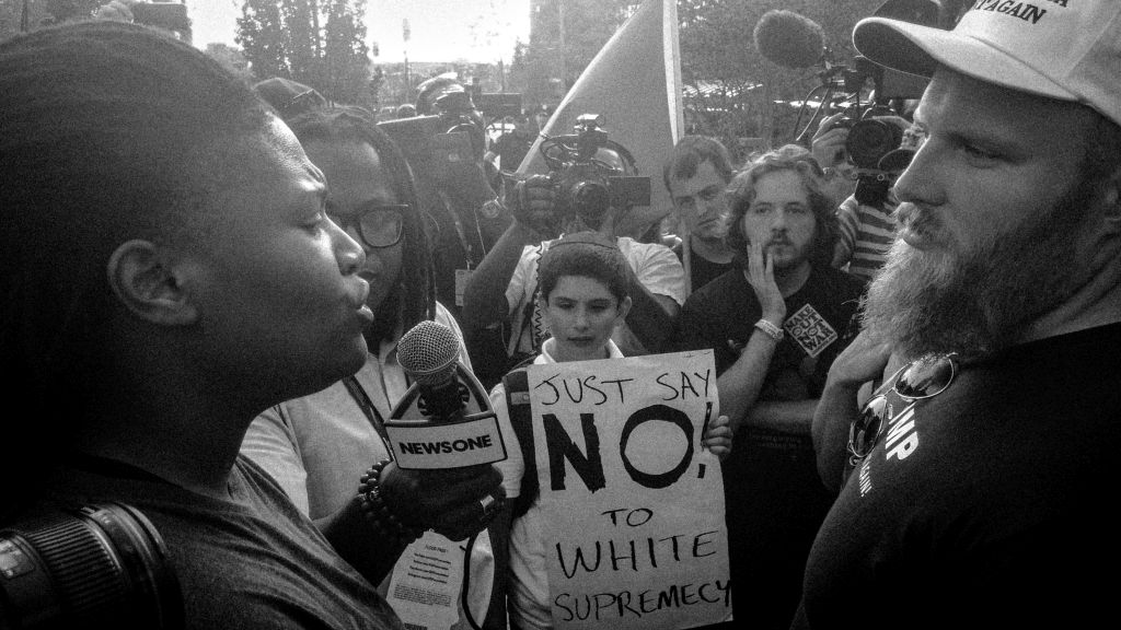 Cleveland, Ohio. 19th July, 2016. An anti-Trump protester (Left) interrogates a race realist (Right) during the 2016 Republican National Convention in Cleveland, Ohio, about his position that there is a general inequality between Africans Americans and Caucasians when it comes to intelligence.