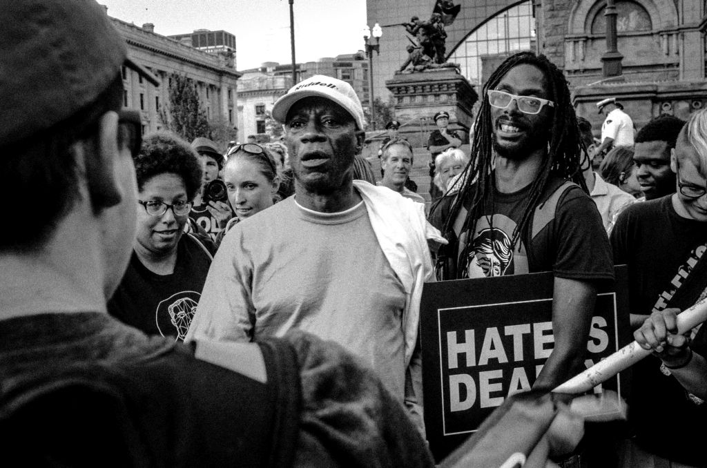 Cleveland, Ohio. 19th July, 2016. A small group of demonstrators surround a sole Trump supporter during the 2016 Republican National Convention in Cleveland, Ohio.